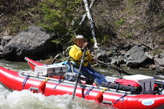 Active Senior whitewater rafting. An active senior whitewater rafting in Idaho Stock Photo