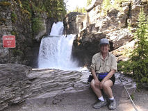 Active Senior woman 1. Senior woman after having hike 10 km to Saint-Mary Falls, East Glacier park USA stock images