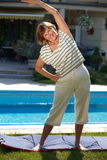 Active senior woman. Happy active senior woman doing workout exercise at home, smiling stock images