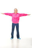 Active senior woman doing sport. Active smiling senior woman doing sport over white background royalty free stock images