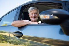 Active senior woman driving a car. Portrait of active senior woman driving a car Royalty Free Stock Photo