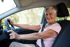 Active senior woman driving a car. Portrait of active senior woman driving a car Stock Photos