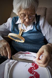 Active senior woman embroidering Stock Photography