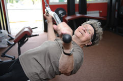 Active senior. Woman excercising at the gym stock photos