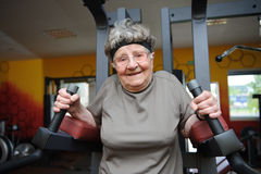 Active senior. Woman excercising at the gym stock photo