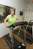 Active Senior Woman Exercise Treadmill Machine. An active senior woman enjoys her retirement and keeps active by exercising in the retirement community exercise Stock Image