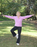 Active senior woman exercising in park Royalty Free Stock Photos
