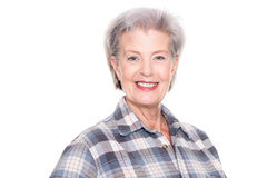 Active senior woman. In front of white background Royalty Free Stock Image