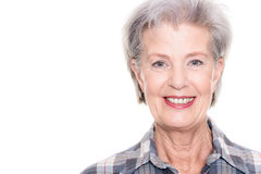 Active senior woman. In front of white background Stock Images