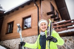 Senior woman getting ready for cross-country skiing. royalty free stock image