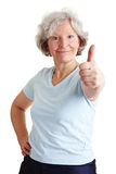 Active senior woman holding thumb Royalty Free Stock Photos