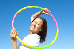 Active senior woman hula hoop exercise Royalty Free Stock Photography