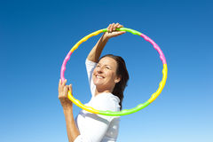 Active senior woman hula hoop exercise Stock Images