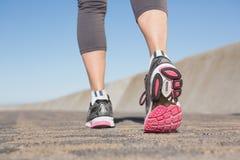 Active senior woman jogging on the pier Stock Photos