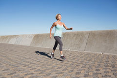 Active senior woman jogging on the pier Royalty Free Stock Images