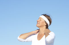 Active senior woman neck pain Royalty Free Stock Image