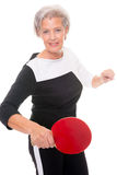 Active senior woman. Playing table tennis in front of white background Royalty Free Stock Photos