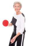 Active senior woman. Playing table tennis in front of white background Stock Image