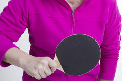 Active senior woman. Playing table tennis in front of white background Royalty Free Stock Photography