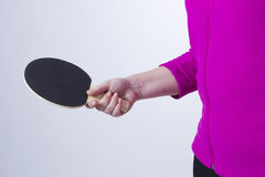 Active senior woman. Playing table tennis in front of white background Royalty Free Stock Image