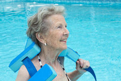 Active senior woman in the pool, doing exercises Royalty Free Stock Photo