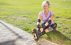 Active senior woman ready to go rollerblading Stock Photo