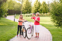 Active senior woman riding bike in a park Royalty Free Stock Photo