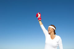 Active senior woman sky background Stock Image