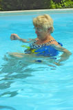 Active senior woman swimming royalty free stock photo