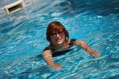 Active senior woman swimming Stock Photos