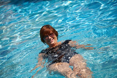 Active senior woman swimming Stock Image