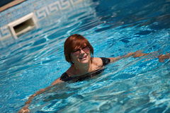Active senior woman swimming Stock Images