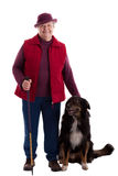Active Senior Woman with walking stick and dog. A lusty female senior with dog looks to viewer royalty free stock photos