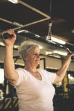 Active senior woman working exercise in the gym. Woman workout in gym Royalty Free Stock Photos