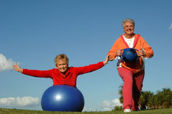 Active senior women. Two senior women with exercise balls outdoors Royalty Free Stock Image