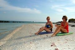 Active senior women at beach stock photos