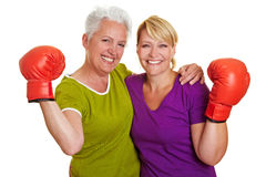 Active senior women with boxing. Two active senior women with red boxing gloves royalty free stock photos