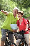 Active seniors. Senior couple on a bike ride, looking at map Stock Photos