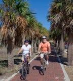 Active Seniors on Bikes. Active senior couple riding bikes on their Florida vacation stock image