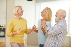 Active seniors dancing boogie-woogie stock images