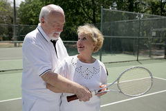 Active Seniors Play Tennis Royalty Free Stock Photo