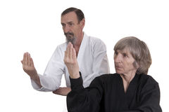 Active seniors practicing martial arts Stock Image
