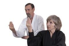 Active seniors practicing martial arts Stock Image