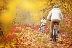 Active seniors riding bike Stock Images