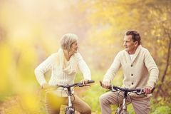 Active seniors riding bike Royalty Free Stock Photo