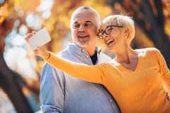Free Active Seniors Taking Selfies Of Them Having Fun Royalty Free Stock Images - 129312199