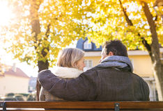 Active seniors in town. Active seniors on a walk in autumn town royalty free stock photos