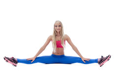 Active slim model posing on split in studio Royalty Free Stock Images