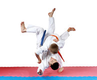 Active small athletes in kimono make tall throw Stock Photo