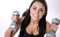 Active Smile Female Lifts Ten Pound Barbells Gym. A happy female is lifting barbells Stock Photos